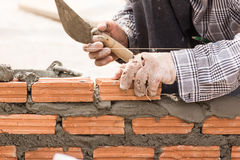 Bricklayer Working In Construction Site Of A Brick Wall Royalty Free Stock Images
