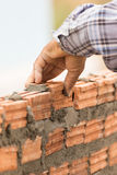 Bricklayer Working In Construction Site Of A Brick Wall Royalty Free Stock Photo