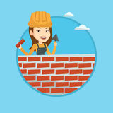 Bricklayer working with spatula and brick. Royalty Free Stock Image