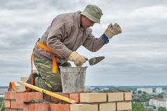 Bricklayer works on 15th floor of building Royalty Free Stock Photo