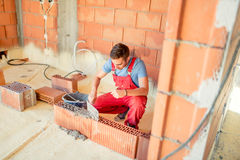 Bricklayering with mason on construction site. Industry details and portraits of workers Stock Photo