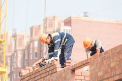 Bricklayers on house construction Stock Images
