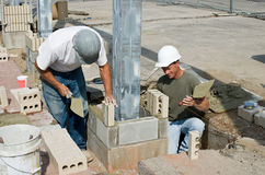 Bricklayers Installing Soldiers. Bricklayers laying vertical bricks which are called 'soldiers Stock Photography