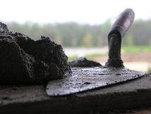Bricklayers Trowel and Mortar Royalty Free Stock Images