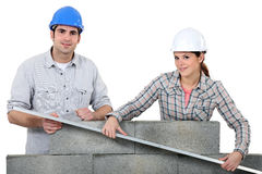 Bricklayers. Two bricklayers building a wall Stock Photography