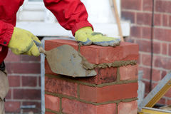 Bricklaying - laying a brick Stock Photo