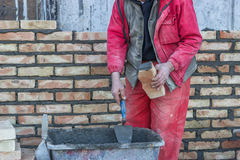 Bricklaying mortar spreading Stock Photo