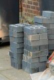 Bricklaying - a pile of black bricks Royalty Free Stock Photo