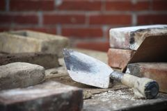 Bricklaying scene with trowel and bricks royalty free stock image