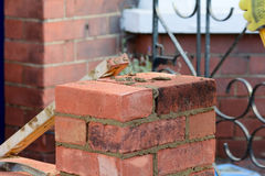 Bricklaying - spirit level resting on wall Stock Image