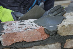 Bricklaying Spreading a Bed Joint Royalty Free Stock Photos