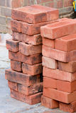 Bricklaying - a stack of red bricks Royalty Free Stock Images