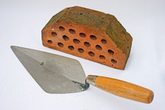 Bricklaying trowel and brick. Royalty Free Stock Photo