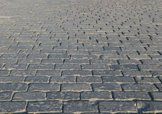 Bricks. Square tiled with weathered bricks Stock Photography