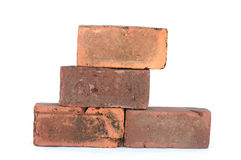 Bricks. Piled on top of each other isolated on white Royalty Free Stock Images