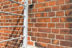 Bricks background and railing Royalty Free Stock Photography
