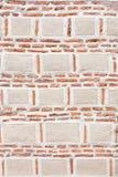 Bricks - big and small. A wall made with big white bricks and small brown bricks stock photo