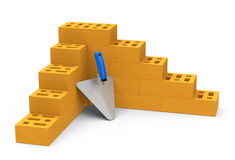 Bricks and brick trowel Stock Photography
