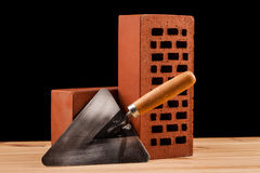 Bricks and builder  tools on black background Stock Photo
