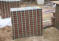 Bricks Custom Stained. Stack of custom stained bricks ready for new home construction Stock Photo