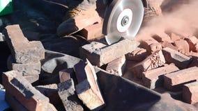 Bricks cut with circular electric saw stock video