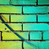 Bricks detail in green tones Stock Images