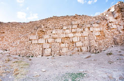 Bricks of different times in the masonry of the old defensive structure of the old town, with destroyed walls Royalty Free Stock Image
