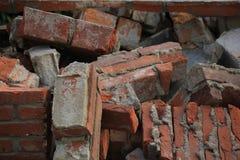 Bricks in a dumpster. Near a construction site, home renovation Stock Photos