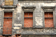 Bricks filled apartment. Old tenement with windows and door filled with bricks - close up royalty free stock image