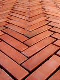Bricks floor. Placed in herringbone shape Royalty Free Stock Images