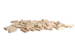 Bricks game Jenga. Scattered on a white background Royalty Free Stock Images