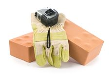 Bricks, glove and tapeline Stock Photography