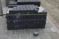 Bricks. Grey /black blocks on street Royalty Free Stock Photos