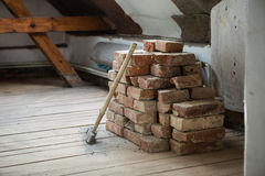 Bricks with a hammer. In the old house before reconstruction stock photos