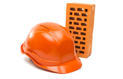 bricks, hard hat isolated Stock Photography