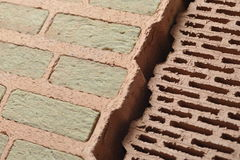 Bricks with insulation. Two types of ceramic bricks with mineral wool insulation and air gaps stock photography