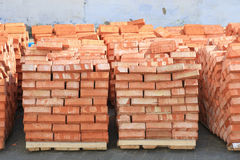 Bricks laid in pallets Stock Photos
