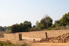 Raw bricks drying, placed in rows royalty free stock images