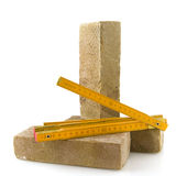 Bricks and measurement tool Royalty Free Stock Images