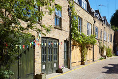 Bricks mews houses in London in a sunny day Stock Photo