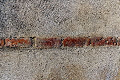 Bricks and mortar. Line of bricks and mortar on a wall Royalty Free Stock Photography