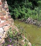 Bricks and muddy waters stock photos