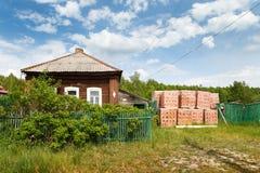 Bricks near old village house Stock Photo