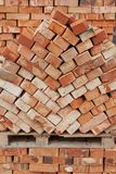 Bricks for next building on wooden pallet Stock Photos