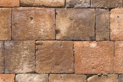 Bricks from old pink tuff in wall texture macro, selective focus, shallow DOF Stock Image