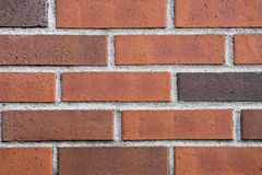 Bricks. Orange and brown bricks with white lines around them Stock Photos