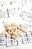 Bricks over blueprint Royalty Free Stock Photos