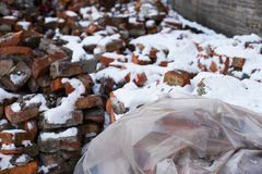 Bricks and polyethylene on snow covered construction site Stock Photography