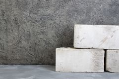 Bricks, putty knife on the gray concrete background. Copy space. Top view. royalty free stock photography