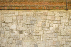 Bricks and rocks wall background texture Stock Images